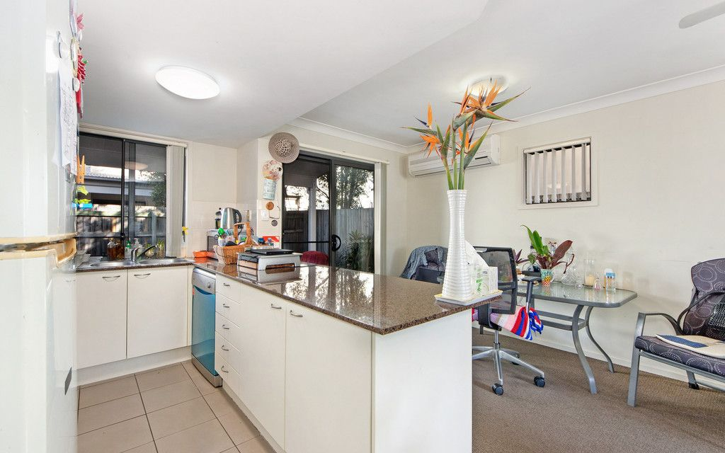 FLOOD FREE TOWNHOUSE WITH LONG-TERM TENANT