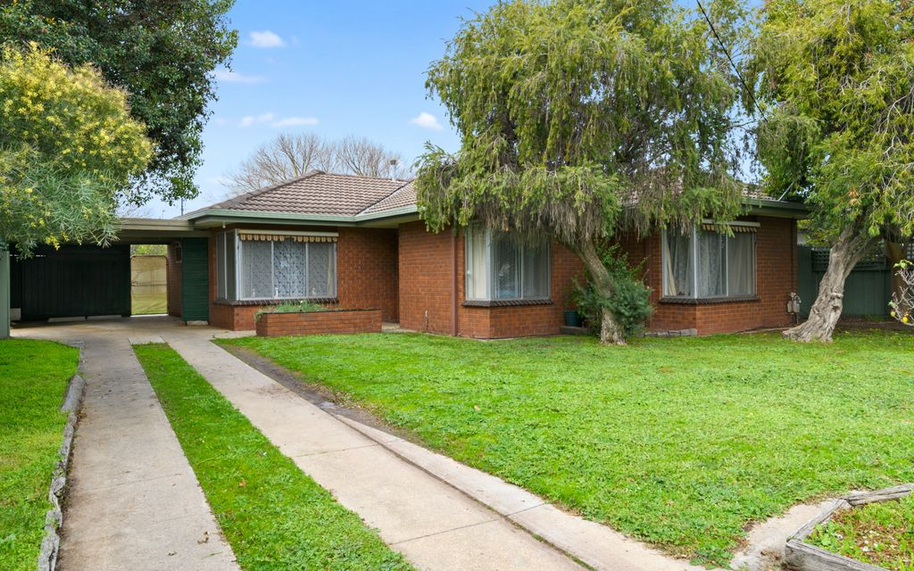 Solid brick home with potential to wow!