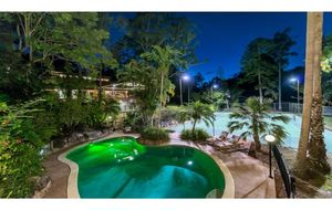 LUSH RAINFOREST RETREAT WITH STUNNING LARGE RESORT-STYLE POOL AND HARD-COURT FLOOD-LIT TENNIS COURT