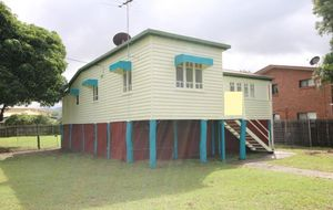 TRADITIONAL HIGHSET WEATHERBOARD HOME ON A VALUEABLE 782m2 CORNER ALLOTMENT PRESENTLY RENTED AT $350 per week..