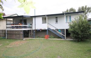 A WELL MAINTAINED HIGH SET 3 BEDROOM HOME - FULL CERAMIC TILE INTERIOR AND A REAR DECK.