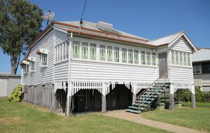 A CLASSIC HIGH SET WEATHERBOARD HOME WITH A PINE INTERIOR - SHED - REAR LANE ACCESS.
