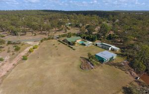 SPACIOUS 4 BEDROOM HOME ON OVER 5 ACRES WITH PLENTY OF SHEDS PLUS POOL TOO!