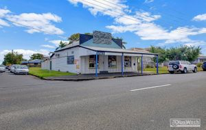 CHARMING COLONIAL COMMERCIAL BUILDING IN A HIGH EXPOSURE LOCATION WITH BATHROOM AND KITCHEN PLUS SHED.