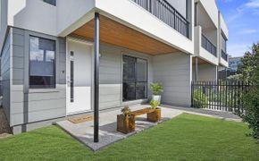 PRICE CHANGE! Low-maintenance luxury in stylish executive townhouse
