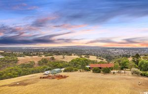 PANORAMIC CITY VIEWS SET ON OVER 10 ACRES OF LAND WITH A 3 BEDROOM FAMILY HOME & SHEDDING