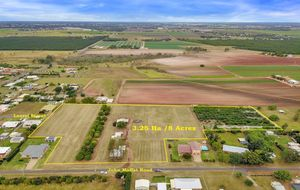 JUST THINK OF THE POSSIBILITIES - 8 ACRES AND 2 STREET ACCESS