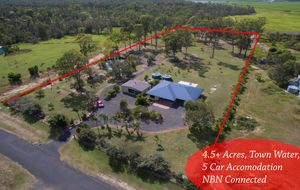 Acreage Living with Town facilities!