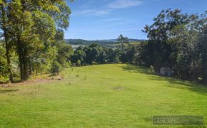 STUNNING ARCHITECT DESIGNED HOME, NEAR 1.5 ACRES OF USABLE LAND.IMMERSE YOURSELF IN SUBLIME BOTANICAL GARDENS!